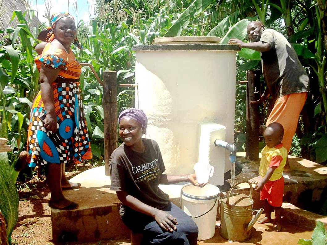 Villagers using one of AquaAids Elephant Pumps